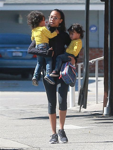 Zoe Saldana carries twin boys while out shopping   Daily